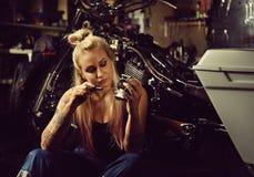 Blond woman mechanic Stock Photography
