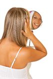 Blond woman with mirror isolated Stock Photo