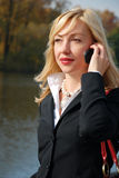 Blond  woman with a mobil Royalty Free Stock Photography