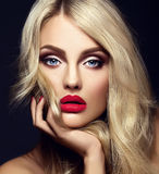 Blond woman model lady with bright makeup and red lips Royalty Free Stock Photography