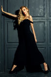 Blond woman model lady in classic black costume Royalty Free Stock Photos