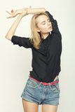 Blond woman model posing in studio Royalty Free Stock Image