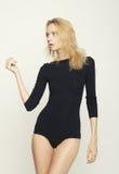 Blond woman model posing in studio Stock Image