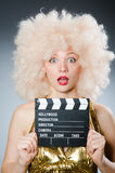 Blond woman. With movie board Stock Photos