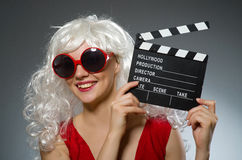 Blond woman. With movie board Royalty Free Stock Images