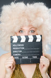 Blond woman. With movie board Royalty Free Stock Photography
