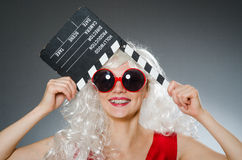 Blond woman with movie Royalty Free Stock Image