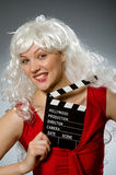 Blond woman. With movie board Royalty Free Stock Image