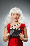 Blond woman. With movie board Royalty Free Stock Photo