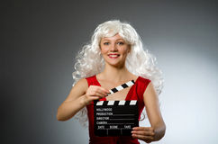 Blond woman. With movie board Royalty Free Stock Photos