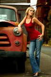 Blond Woman next to old truck Stock Photo