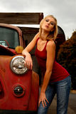 Blond Woman next to old truck Royalty Free Stock Images