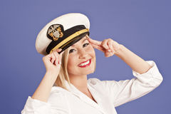 Blond woman in officers cap Royalty Free Stock Image