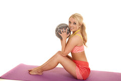 Blond woman orange fitness sit with medicine ball Royalty Free Stock Photos