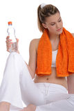 Blond woman with orange fitness towel Stock Image