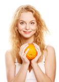 Blond woman with oranges in her hands Stock Image