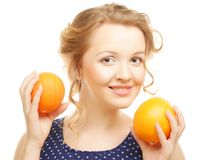 Blond  woman with oranges Stock Photography