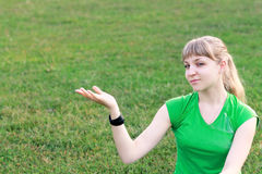 Blond woman outdoor holding Stock Images