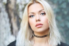 Blond woman outdoor. Portrait of beautiful blond woman outdoor face close up Stock Image