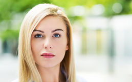 Blond woman outdoors Royalty Free Stock Image