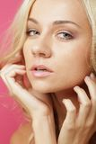 Blond woman over pink background Royalty Free Stock Photography