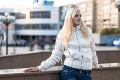 Blond woman over urban background Stock Photo