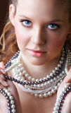 Blond woman in pearls Stock Photo