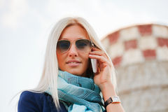 Blond woman on the phone Royalty Free Stock Image