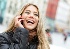 Blond woman on the phone Royalty Free Stock Images