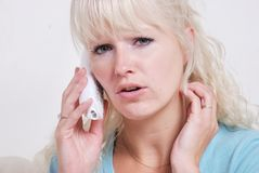 Blond woman phoning Royalty Free Stock Photos
