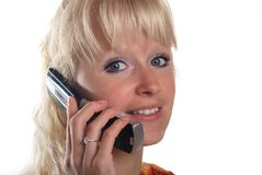 Blond woman phoning Stock Photos