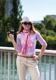 Blond woman with photocamera and cowboy's hat Royalty Free Stock Photography