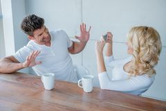 Blond woman photographing her husband Royalty Free Stock Photos