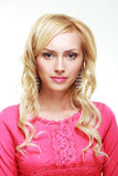 Blond woman in pink Royalty Free Stock Photo