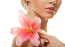 Blond woman with pink lily Royalty Free Stock Photo