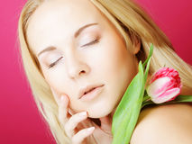 Blond woman with pink tulip Royalty Free Stock Photo