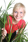 Blond woman with plant Stock Photo