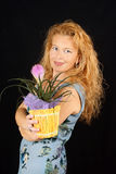 Blond woman with plant Royalty Free Stock Image