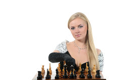 Blond woman play chess Stock Photo