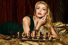 Blond woman playing chess Royalty Free Stock Photo