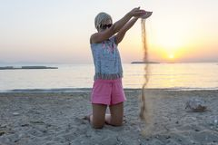 Blond woman plays with the sand Stock Photo