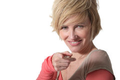 Blond woman pointing Stock Photo