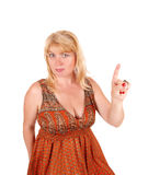 Blond woman pointing finger. A portrait image of a blond woman in her forties looking serious and Stock Images