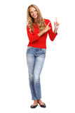 Blond woman pointing her finger towards copyspace Stock Photos