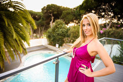 Blond woman by the pool Royalty Free Stock Images