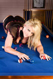Blond woman on pool table Stock Images