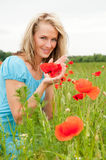 Blond woman with poppy Royalty Free Stock Photography