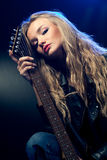 Blond woman portrait with guitar Royalty Free Stock Photography