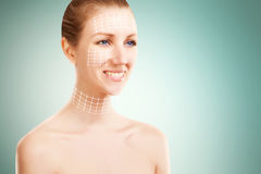 Blond woman portrait with surgery marks on blue. Elegant blond woman portrait with surgery marks for lifting Stock Photo