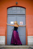 Blond woman posing in doorway Stock Images